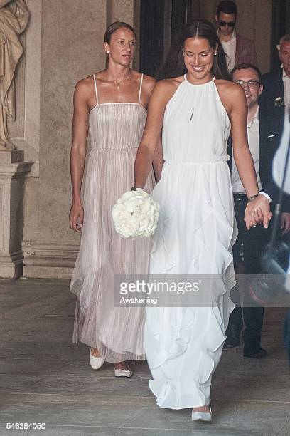 Ana Ivanovic followed by Miroslava Najdanovski comes out of the wedding hall followed by Miroslava Najdanovski at Palazzo Cavalli after the...