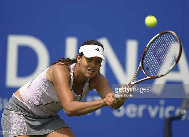 Ana Ivanovic of Serbia and Montenegro returns a service from Alicia Molik of Australia during an Ordina Open first round tennis match on June 18 2006...