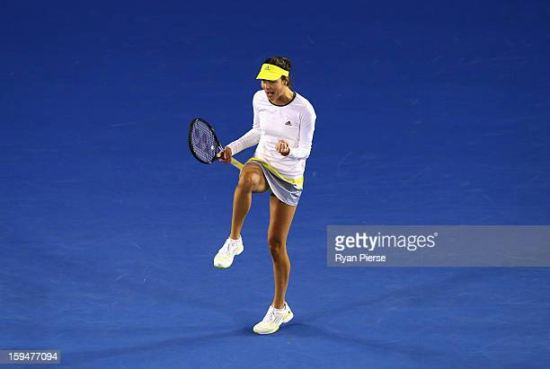 Ana Ivanovic of Serbia celebarates during her first round match against Melinda Czink of Hungary during day one of the 2013 Australian Open at...