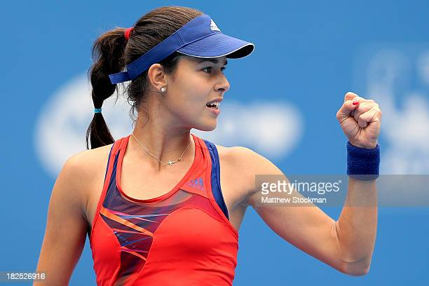 Ana Ivanovic of Serbia celebrates a point against Flavia Pennetta of Italy during day three of the 2013 China Open at the National Tennis Center on...