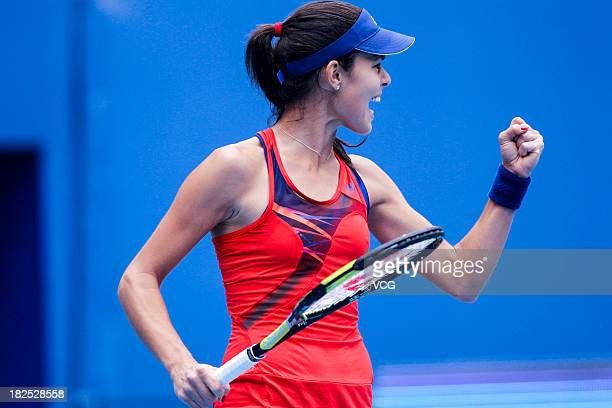 Ana Ivanovic of Serbia celebrates a point against Flavia Pennetta of Italy on day three of the 2013 China Open at National Tennis Center on September...