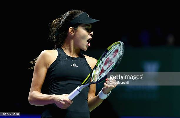 Ana Ivanovic of Serbia celebrates a point in the first set against Simona Halep of Romania in their round robin match during the BNP Paribas WTA...
