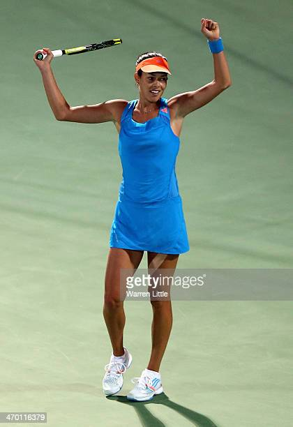 Ana Ivanovic of Serbia celebrates beating Angelique Kerber of Germany in a tie break during day two of the WTA Dubai Duty Free Tennis Championship at...