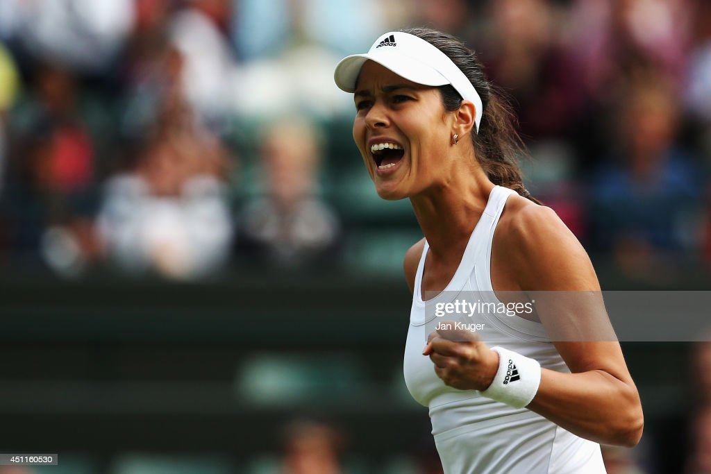 Ana Ivanovic of Serbia celebrates during her Ladies' Singles first round match against Francesca Schiavone of Italy on day two of the Wimbledon Lawn Tennis Championships at the All England Lawn Tennis and Croquet Club at Wimbledon on June 24, 2014 in London, England.