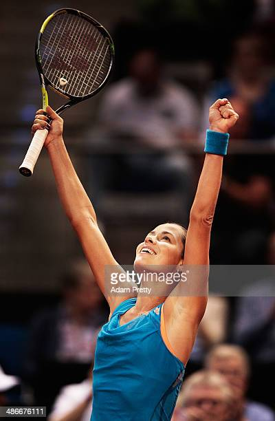 Ana Ivanovic of Serbia celebrates match point after her match against Svetlana Kuznetsova of Russia on day five of the Porsche Tennis Grand Prix at...