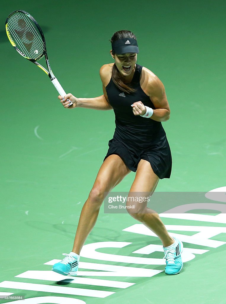 Ana Ivanovic of Serbia celebrates match point and a straight sets victory against Eugenie Bouchard of Canada in their round robin match during the BNP Paribas WTA Finals at Singapore Sports Hub on October 22, 2014 in Singapore.