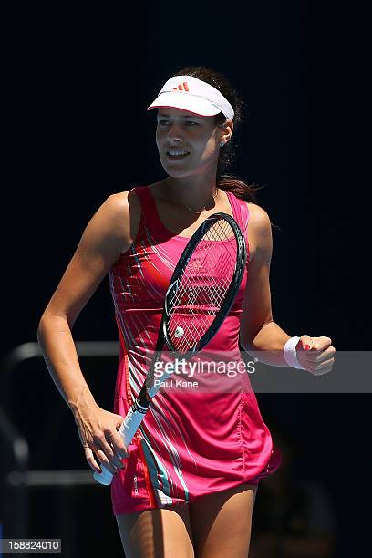 Ana Ivanovic of Serbia celebrates winning a set in her singles match against Francesca Schiavone of Italy during day three of the Hopman Cup at Perth...