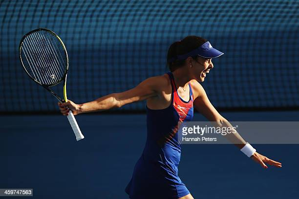 Ana Ivanovic of Serbia celebrates winning her doubles match with Kirsten Flipkens of Belgium against Irina Falconi of the USA and Eva Hrdinova of the...