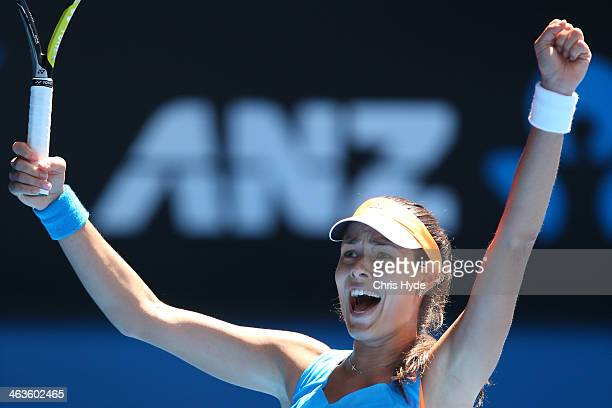 Ana Ivanovic of Serbia celebrates winning her fourth round match against Serena Williams of the United States during day seven of the 2014 Australian...