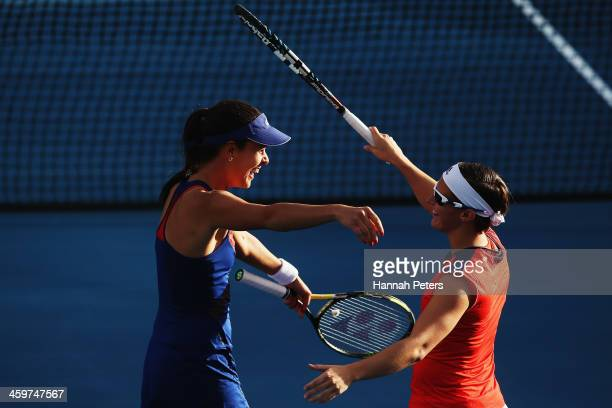 Ana Ivanovic of Serbia celebrates with Kirsten Flipkens of Belgium after winning their doubles match against Irina Falconi of the USA and Eva...