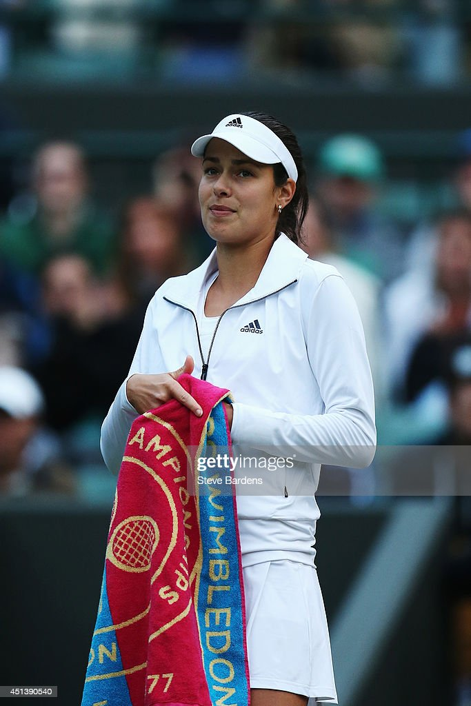 Ana Ivanovic of Serbia gets ready to walk off after complaining about how dark it is during her Ladies' Singles third round match against Sabine Lisicki of Germany on day six of the Wimbledon Lawn Tennis Championships at the All England Lawn Tennis and Croquet Club at Wimbledon on June 28, 2014 in London, England.