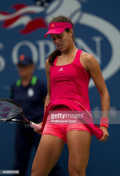 Ana Ivanovic of Serbia having problems with her dress during the match against Serena Williams of the United States during Day Eight of the 2011 US...