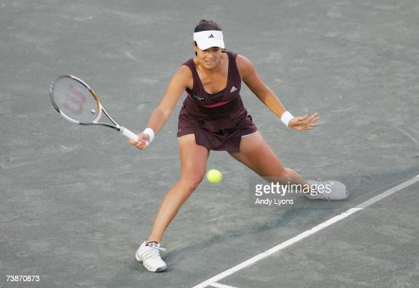 Ana Ivanovic of Serbia hits a return in her match against Vera Zvonareva of Russia during the Family Circle Cup at the Family Circle Tennis Center on...
