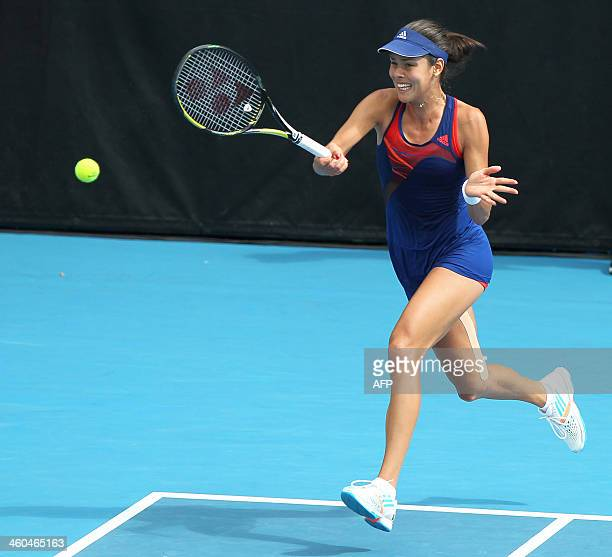 Ana Ivanovic of Serbia hits the ball against Venus Williams of the US during their singles final at the ASB Classic tennis tournament in Auckland on...