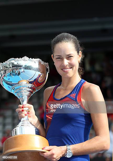 Ana Ivanovic of Serbia holds her trophy after her win during the final against Venus Williams of the US at the ASB Classic tennis tournament in...
