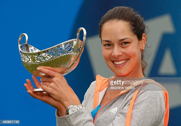 Ana Ivanovic of Serbia holds up the Maud Watson trophy after beating Barbora Zahlavova Strycova of Czech Republic in the final of the WTA AEGON...