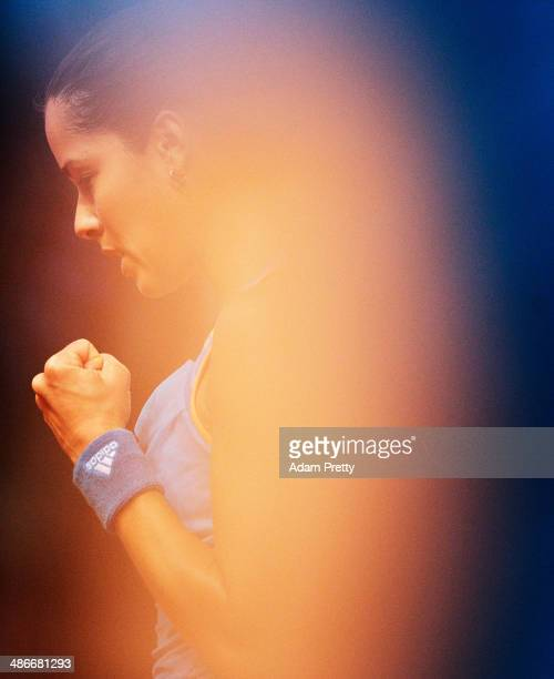 Ana Ivanovic of Serbia is obscured by a ball girl as she celebrates during her match against Svetlana Kuznetsova of Russia on day five of the Porsche...