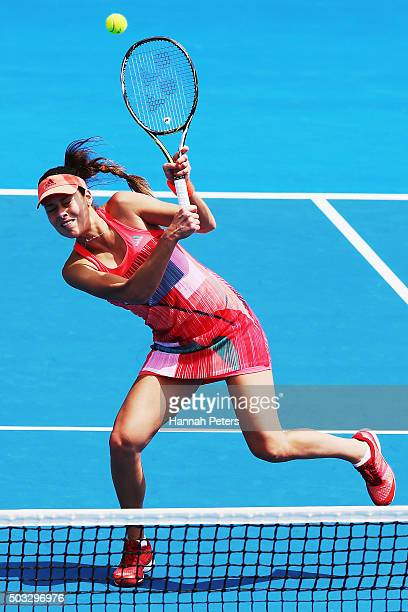 Ana Ivanovic of Serbia plays a backhand during her first round doubles match with Kirsten Flipkens of Belgium against Andrea Hlavackova and Lucie...