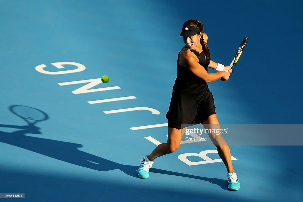 Ana Ivanovic of Serbia plays a backhand in her match against Sabine Lisicki of Germany during day six of of the China Open at the National Tennis Center on October 2, 2014 in Beijing, China.