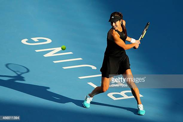 Ana Ivanovic of Serbia plays a backhand in her match against Sabine Lisicki of Germany during day six of of the China Open at the National Tennis...