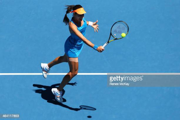 Ana Ivanovic of Serbia plays a backhand in her quarterfinal match against Eugenie Bouchard of Canada during day nine of the 2014 Australian Open at...