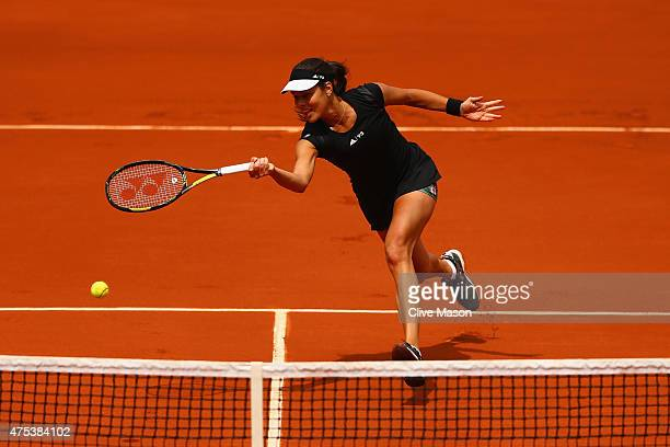 Ana Ivanovic of Serbia plays a forehand in her Women's Singles match against Ekaterina Makarova of Russia on day eight of the 2015 French Open at...