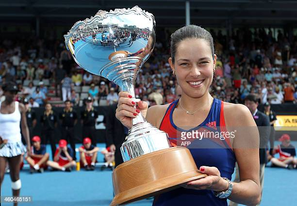 Ana Ivanovic of Serbia poses with her trophy after her win in the singles final at the ASB Classic tennis tournament in Auckland on January 4 2014...