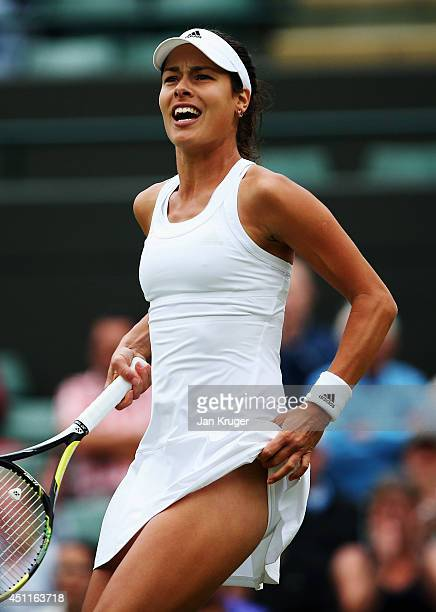 Ana Ivanovic of Serbia reacts after winning her Ladies' Singles first round match against Francesca Schiavone of Italy on day two of the Wimbledon...