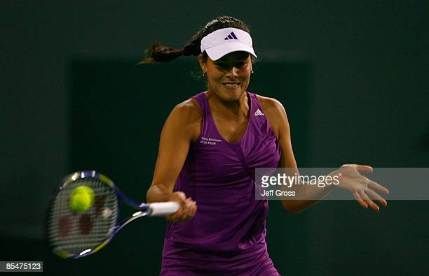 Ana Ivanovic of Serbia returns a forehand to Flavia Pennetta during the BNP Paribas Open at the Indian Wells Tennis Garden on March 17 2009 in Indian...
