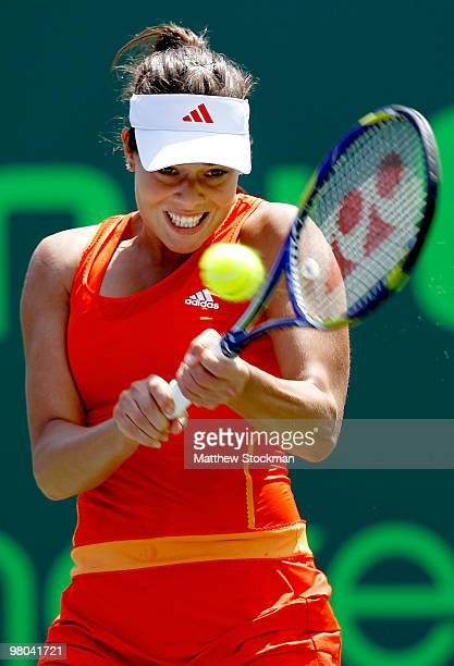 Ana Ivanovic of Serbia returns a shot against Pauline Parmentier of France during day three of the 2010 Sony Ericsson Open at Crandon Park Tennis...