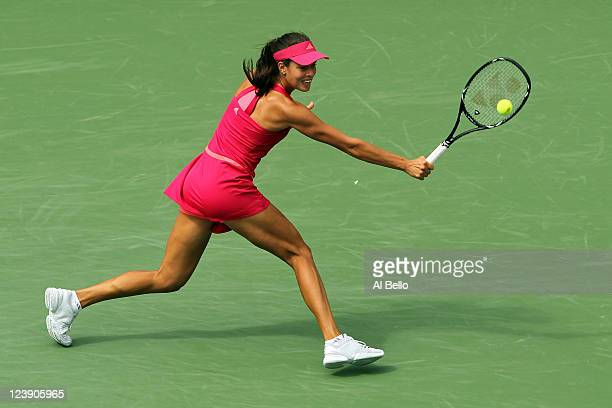 Ana Ivanovic of Serbia returns a shot against Serena Williams of the United States during Day Eight of the 2011 US Open at the USTA Billie Jean King...
