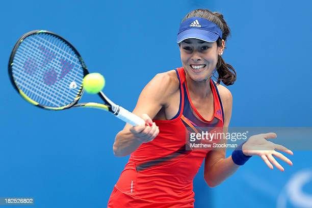 Ana Ivanovic of Serbia returns a shot to Flavia Pennetta of Italy during day three of the 2013 China Open at the National Tennis Center on September...