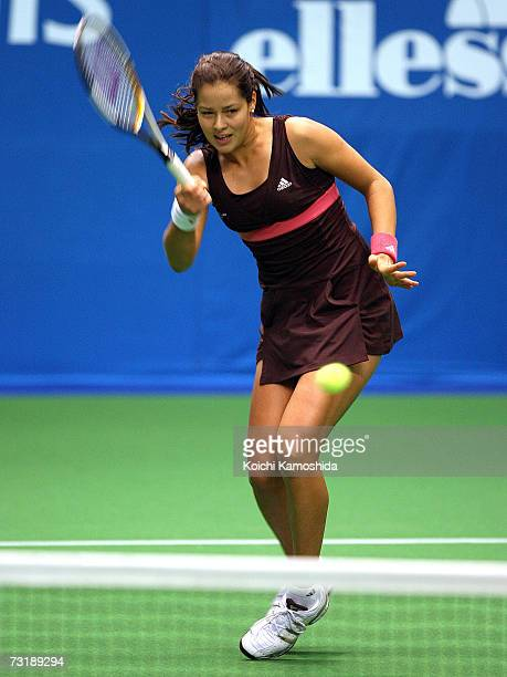 Ana Ivanovic of Serbia returns the ball during her semifinal women's singles match against Maria Sharapova of Russia at the Toray Pan Pacific...