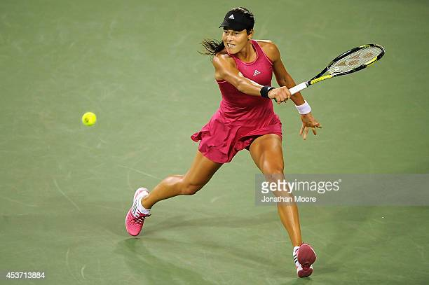 Ana Ivanovic of Serbia returns to Maria Sharapova of Russia during a match on day 8 of the Western Southern Open at the Linder Family Tennis Center...
