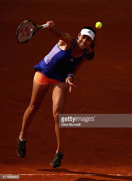 Ana Ivanovic of Serbia serves against Alexandra Dulgheru of Romania in their first round match during day one of the Mutua Madrid Open tennis...