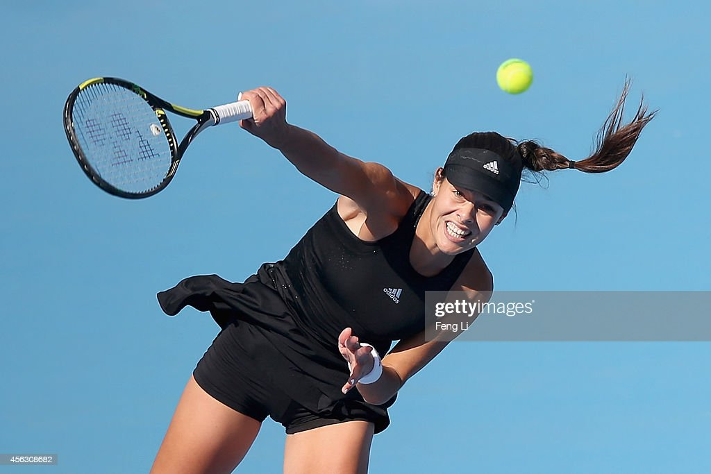 Ana Ivanovic of Serbia serves against Belinda Bencic of Switzerland during day three of the China Open at the China National Tennis Center on September 29, 2014 in Beijing, China.