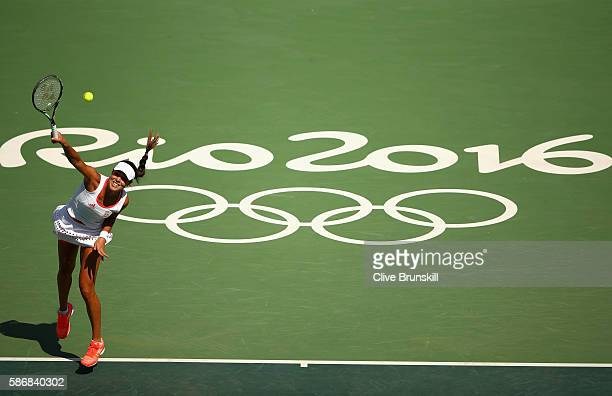 Ana Ivanovic of Serbia serves against Carla Suarez Navarro of Spain in their first round match on Day 1 of the Rio 2016 Olympic Games at the Olympic...