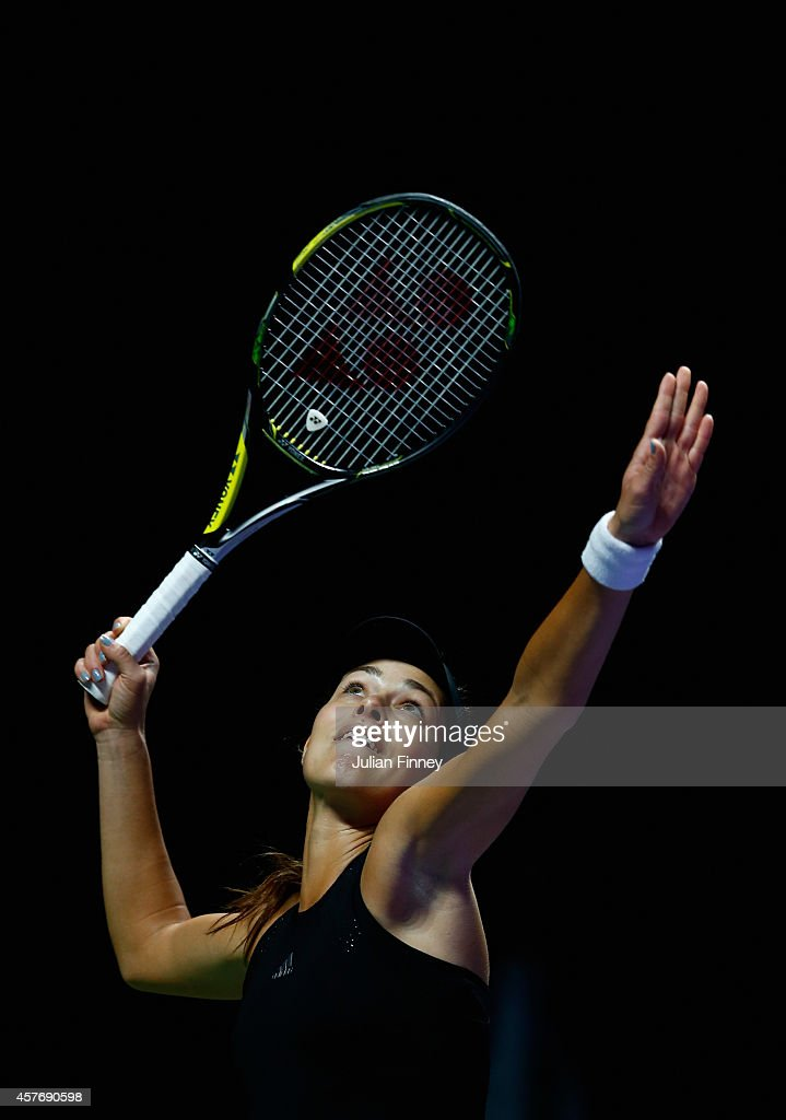 Ana Ivanovic of Serbia serves against Eugenie Bouchard of Canada during day three of the BNP Paribas WTA Finals tennis at the Singapore Sports Hub on October 22, 2014 in Singapore.