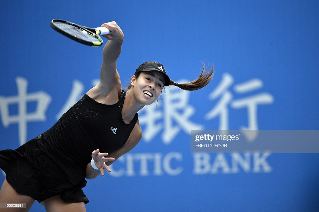 Ana Ivanovic of Serbia serves against Sabine Lisicki of Germany during their women's singles third round match at the China Open tennis tournament in the National Tennis Center of Beijing on October 2, 2014.