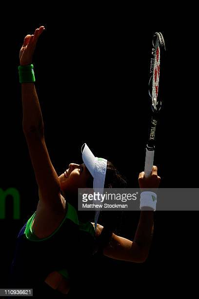 Ana Ivanovic of Serbia serves against Virginie Razzano of France during the Sony Ericsson Open at Crandon Park Tennis Center on March 27 2011 in Key...
