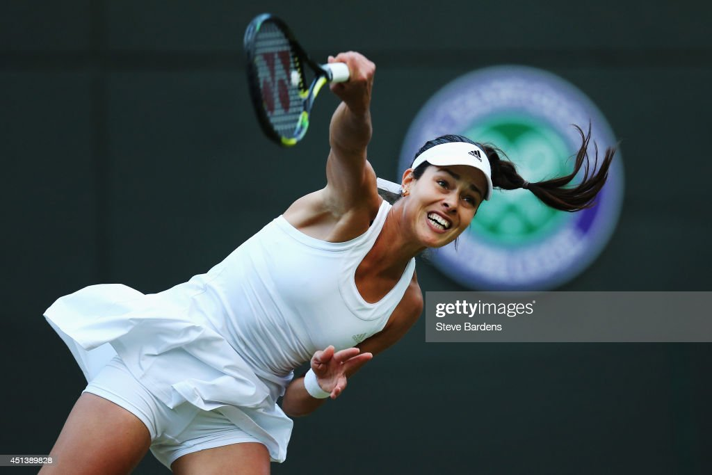 Ana Ivanovic of Serbia serves during her Ladies' Singles third round match against Sabine Lisicki of Germany on day six of the Wimbledon Lawn Tennis Championships at the All England Lawn Tennis and Croquet Club at Wimbledon on June 28, 2014 in London, England.