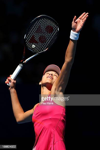 Ana Ivanovic of Serbia serves in her singles match against Francesca Schiavone of Italy during day three of the Hopman Cup at Perth Arena on December...