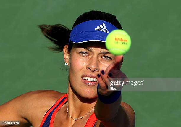 Ana Ivanovic of Serbia serves to Alexandra Dulgheru of Romania during their second round women's singles match on Day Four of the 2013 US Open at...