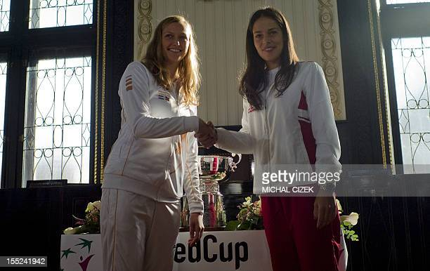 Ana Ivanovic of Serbia shakes hand with Petra Kvitiva of Czech Republic after the International Tennis Federation Fed Cup final draw ceremony on...