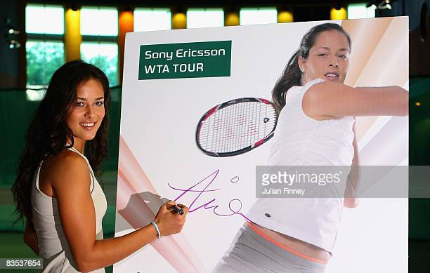 Ana Ivanovic of Serbia signs a photo of herself before a press conference for the Sony Ericsson WTA Championships at the Ritz Carlton hotel on...