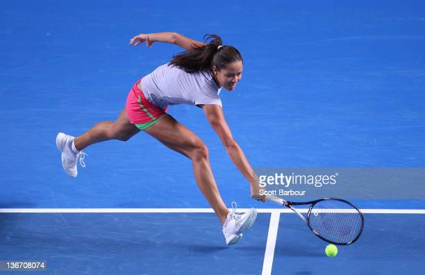 Ana Ivanovic of Serbia stretches for the ball during a practice session prior to the 2012 Australian Open at Rod Laver Arena on January 11 2012 in...