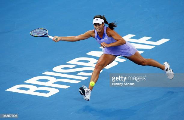 Ana Ivanovic of Serbia stretches out as she attempts to play a forehand in her first round match against Jelena Dokic of Australia during day two of...