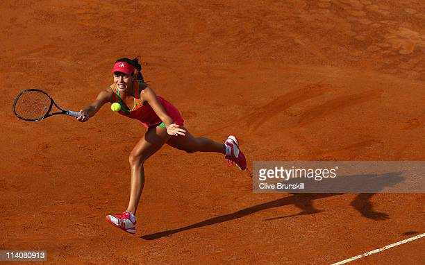 Ana Ivanovic of Serbia stretches to play a forehand during her second round match against Yanina Wickmayer of Belgium during day four of the...