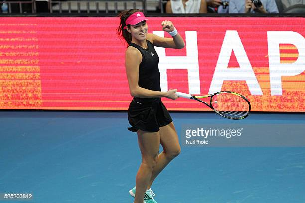 Ana Ivanovic of the Indian Aces celebrates after scoring a point against Daniela Hantuchov�� of the Singapore Slammers during their singles match at...
