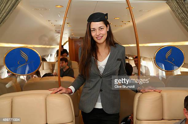 Ana Ivanovic of the Indian Aces poses for a photograph in her stewardess outfit during the players flight on a private jet from Manila to Singapore...